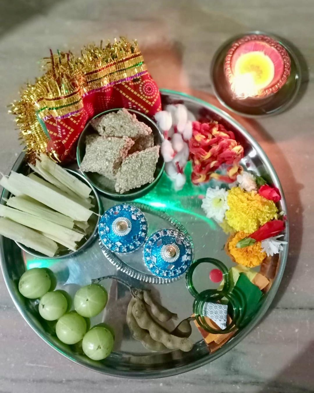 Tulsi puja  symbolizes Goddess Lakshmi, the consort of Lord Vishnu. The Tulsi leaf has great medicinal value as it cures various ailments, including the common cold.  The foods offered welcomes new seasonal food like sugarcane, amla, sesame seeds all these has their own significance in our health. #diwali #tusipuja #tulsi