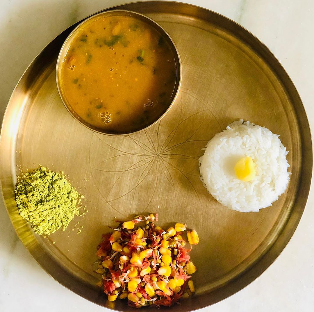 Lunch for today  Yes u can see rice and ghee both the things that people fear to include in their diet. But a balanced diet doesn't recommend any restriction and that is what all my clients are enjoying.  My meal is  Rice with ghee  Dal - without sugar/ jaggery - (specially for all my gujaratis)  Sprouts salad  Curry leaves chutney  #kpmeal #healthymeal #balancedmeal #komalpatel